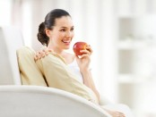 happy-woman-eating-an-apple